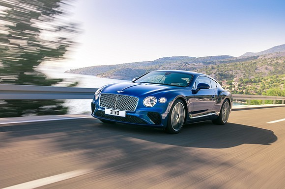 The Bentley Continental GT has a big, powerful V12 engine, but it's no Ferrari. It's also got a classic design ...