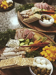 Chef Dorien Murphy's Tomato/Mozz/Balsamic Fig Croustini which features Poached Fig/Goat Cheese/Herb Bread Charcuterie and Crudite along with Italian Meats/Cheeses/Veg