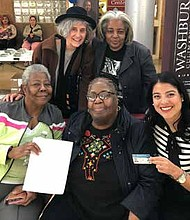 City Clerk of Chicago, Anna M. Valencia (far right), has spearheaded the Chicago CityKey program as a way to remove barriers for residents. In 2019, she plans to continue to expand the program. Photo Credit: Courtesy of the Office of the City Clerk of Chicago