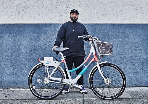 "Nike designer Marcellus Johnson shows off the ""culture collection"" bike wrap he created for Black History Month and Portland's Biketown bicycle rental service."