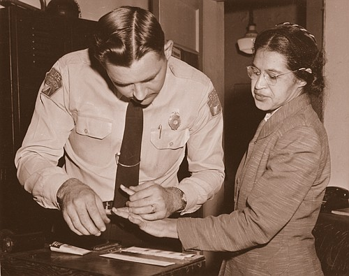 Rosa Parks being fingerprinted in February 1956 by Deputy Sheriff D.H. Lackey after being arrested for boycotting public transportation in Montgomery, Ala.