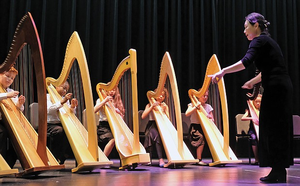 The RPS Harp Ensemble, comprised of middle school students in Richmond Public Schools, add a musical touch to the first State of the Schools presentation Tuesday night by Superintendent Jason Kamras, who is marking his first anniversary in the job. The event was held at Martin Luther King Jr. Middle School in the East End.