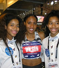 800-meter winner Ajee Wilson (center) flanked by Brooklyn track twins Ka' Mani (left), and Madison Brown.