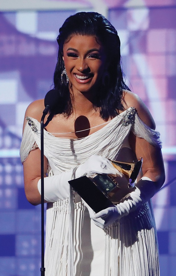 """Cardi B accepts the Best Rap Album award for """"Invasion of Privacy,"""" her first Grammy Award."""