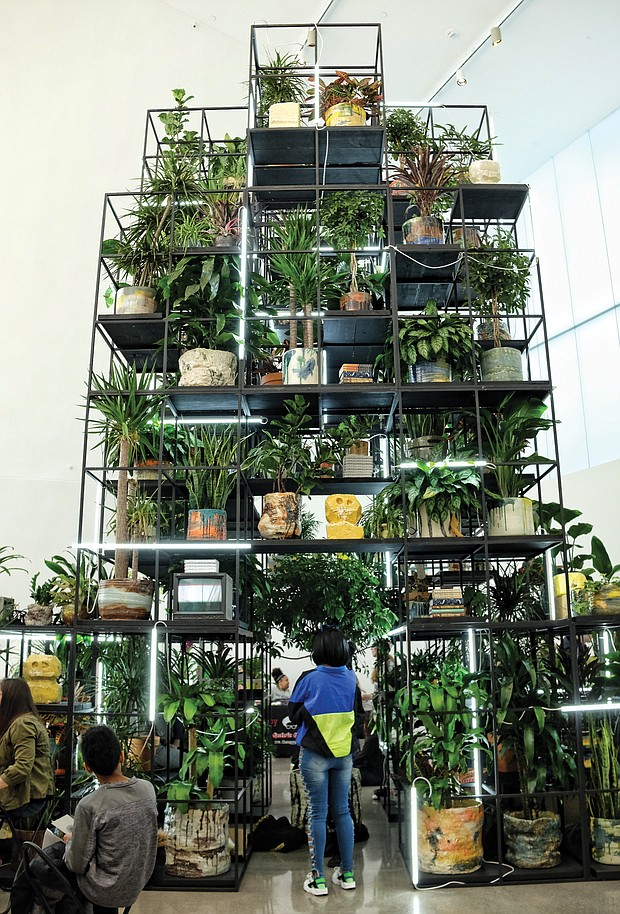 """Afroecology at ICA/ The multi-tiered greenery of Rashid Johnson's """"Monument"""" serves as a centerpiece for a two-day Afroecology program held last weekend at Virginia Commonwealth University's Institute for Contemporary Art featuring musical guests, visiting artists and craftspersons.  """"Monument"""" is part of the """"Provocations"""" exhibit showcasing Mr. Johnson's work that will be on view through July 14 at the ICA, 601 W. Broad St. (Sandra Sellars/Richmond Free Press)"""