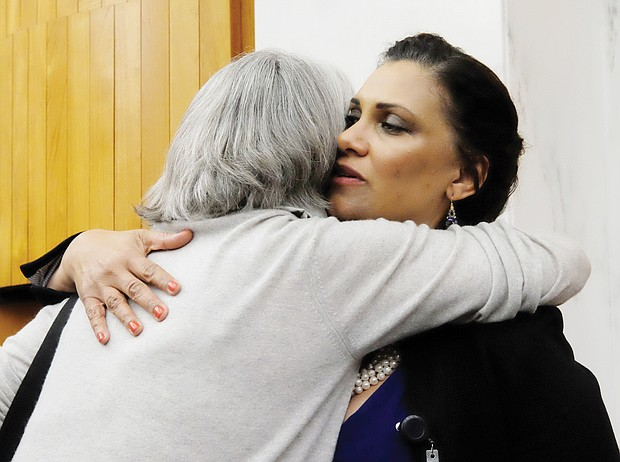 City Councilwoman Kim B. Gray get a huge hug from a supporter after Monday night's vote to rename the Boulevard in honor of Arthur Ashe Jr.