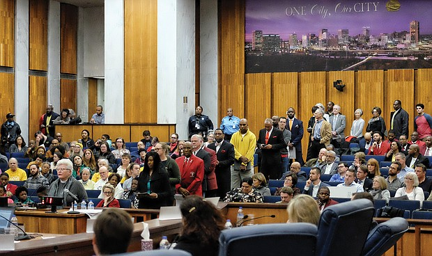A long line of people wait their turn to speak before Richmond City Council Monday night on renaming the street Arthur Ashe Boulevard.