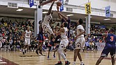 Virginia Union University and Virginia State University players go airborne under the basket in the hard-fought game last Saturday ad Barco-Sevens Hall.