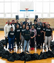 11-year-old Jahkil Jackson, founder of Project I Am, (center) recently partnered with Nike to celebrate Black History Month by hosting a community service day. Photo Credit: Nike Chicago