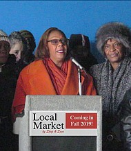 Ald. Leslie Hairston (c) stands with 5th Ward residents at news conference announcing the opening of a new grocery store to replace the vacant Dominick's in Jeffery Plaza, 2101 E. 71st St.  The announcement took place inside the store where construction is underway already. The new Shop & Save Local Market will be a full-service grocery store.  Residents have been without a major grocer since Dominick's went out of business more than five years ago.
