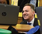 Richmond Superintendent Jason Kamras finishes a recent day visiting 12 schools by watching a student work on a laptop at Barack Obama Elementary School.