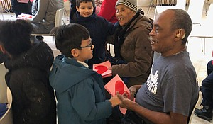 Seniors from The Carter Burden Network/Leonard Covello Senior Center receiving Valentines from St. Ann students.