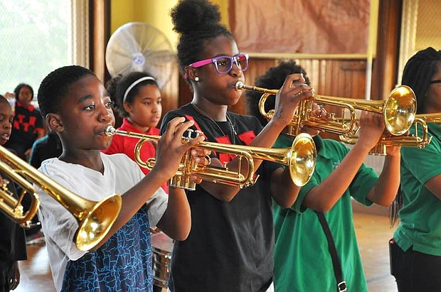 Students at Betty Shabazz International Charter Schools hone their music skills.
