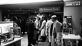 Richmond Police try to move Virginia Union University students out of The Richmond Room restaurant in Thalhimer's department store in Downtown where they refused to leave, protesting the whites-only policy for service. Dr. A.J. Franklin is the student at center wearing the raincoat that is slightly open.