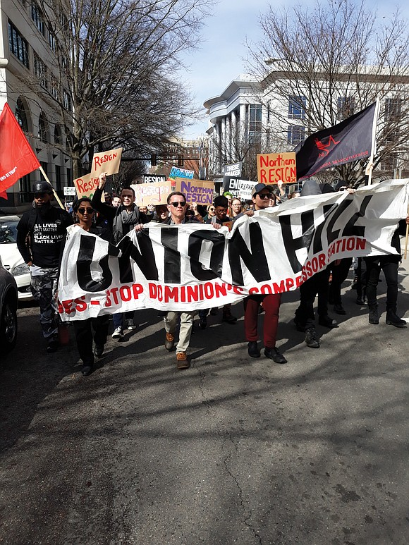 Banks and schools may have been closed Monday, but around 50 political activists descended on Bank Street and went to ...