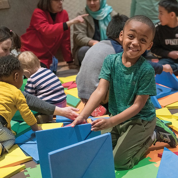 Creating his own fun: Carter Powers, 4, puts his creative powers to use last Saturday during the Virginia Museum of Fine Arts' ChinaFest: Year of the Earth Pig celebration for the lunar new year. (Ava Reaves)