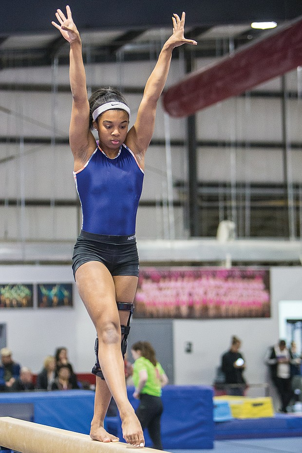 Chesterfield County athlete Elexis 'Lexi' Edwards shows her gymnastic skills on the balance beam.