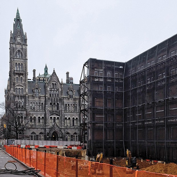 Work is underway at 9th and Broad streets on a new 15-story office building for members of the General Assembly. The previous General Assembly Building, as it was called, was torn down last year, with only the historic 1912 façade saved for incorporation into the new building. The façade is being held in place with metal scaffolding. The new building is expected to be completed in 2021. About $300 million is being invested in the new construction and in the renovation of Old City Hall, seen in the background. For now, General Assembly members have offices in temporary quarters in the Pocahontas Building on Main Street. (Sandra Sellars/Richmond Free Press)