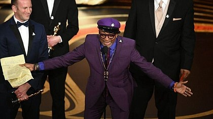 "Spike Lee accepts the Oscar for adapted screenplay for ""BlacKkKlansman."" (Kevin Winter / Getty Images)"