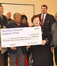 Nina Graham (front row, second from left), president of the Board of Education for Thornton Township High School District 205, recently accepted a $130,000 donation from the Thornton Alumni Legacy Fund which will be used to create a machine shop program in the district. Photo Credit: Thornton Township High School District 205.