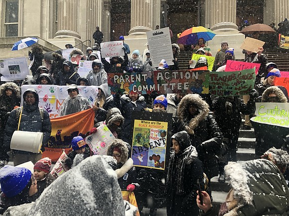 On Wednesday, Feb. 20 the Coalition for Educational Justice gathered with parents and kids in blustery conditions on the steps ...