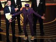 "A gleeful Spike Lee gives an impassioned acceptance speech Sunday upon winning the Academy Award for best adapted screenplay for ""BlacKkKlansman."""