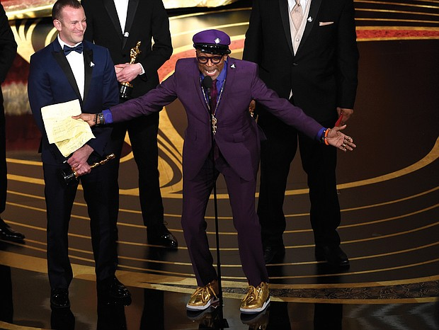 """A gleeful Spike Lee gives an impassioned acceptance speech Sunday upon winning the Academy Award for best adapted screenplay for """"BlacKkKlansman."""""""