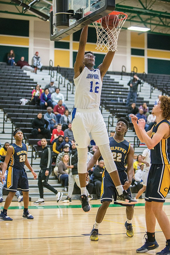 In its quest for a second straight state basketball title, Richmond's John Marshall High School has switched from a No. ...