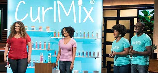 Kim and Tim Lewis (pictured in blue shirts) are the co-founders of CurlMix, a natural hair care line for curly hair, and recently presented their business idea to the panel of investors on Shark Tank. Photo Credit: CurlMix.