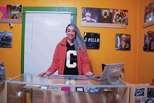 Kaitlyn Verret is employed as a budtender, helping customers pick from a selection of legal cannabis to purchase for recreational use at the Green Hop dispensary, a black-owned business on Northeast Killingsworth Street.