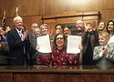 Oregon Gov. Kate Brown holds a ceremony Thursday to sign a rent control law at the State Capitol in Salem. The bill ismeant to address a housing crisis that has touched every corner of the state.  (AP photo)