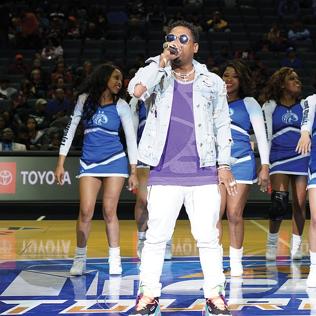 CIAA!: The annual CIAA Tournament is known for its fun — inside and outside the basketball arena. And this year in Charlotte, N.C., was no exception, as HBCU alumni, fans and family enjoyed four days of food, fun and activities in the Queen City. Singer, songwriter and actor Bobby V, right, takes the mic during halftime at the men's final on Saturday, where Fayetteville State University cheerleaders were his backup dancers. (photos by Randy Singleton)