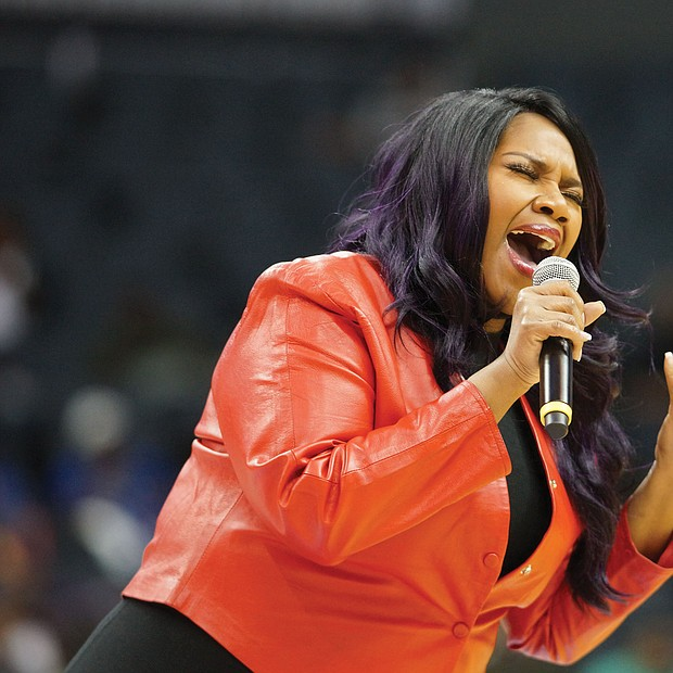 CIAA!: The annual CIAA Tournament is known for its fun — inside and outside the basketball arena. And this year in Charlotte, N.C., was no exception, as HBCU alumni, fans and family enjoyed four days of food, fun and activities in the Queen City. Nine-time Grammy nominee Kelly Price entertains the audience during halftime at the women's championship game Saturday. (photos by Randy Singleton)