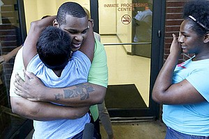 Alfred Dewayne Brown hugged his sister Connie Brown on the day of his release, June 8, 2015.