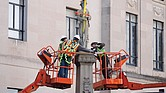 Workers make final preparations before removing a statue of a Confederate soldier from its base in Winston-Salem, N.C., on Tuesday. The statue is to be placed in a historic cemetery.
