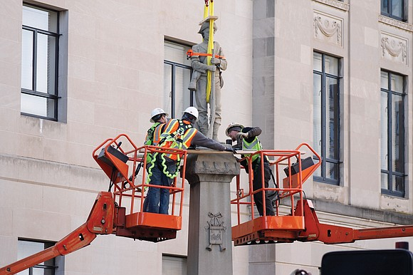 The city of Winston-Salem, N.C., removed a Confederate statue Tuesday from the grounds of an old courthouse, drawing applause from ...