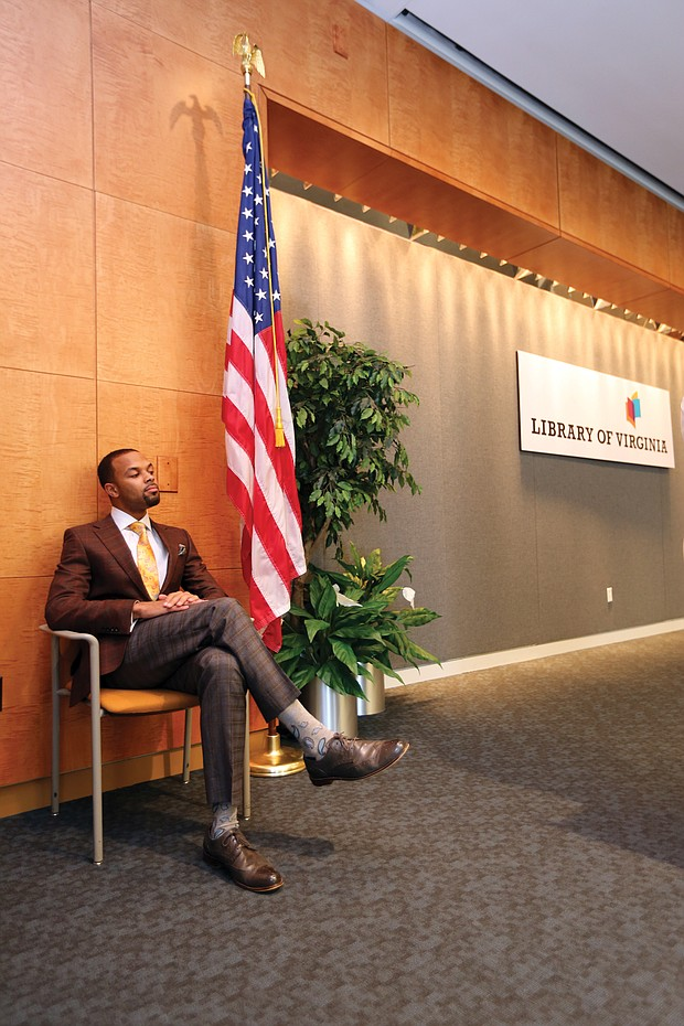 """Confidently waiting: Columnist Zachary R. Woods, author of """"Uncensored: My Life and Uncomfortable Conversations at the Intersection of Black  and White America,"""" listens as he is introduced as the first speaker of the 2019 Carole Weinstein Author Series at the Library of Virginia in Downtown on March 5. The next speaker in the free series is Khizr Khan, author of """"An American Family: A Memoir of Hope and Sacrifice."""" He will speak at 5:30 p.m. Thursday, April 4. Details: www.lva.virginia.gov. (Regina H. Boone/Richmond Free Press)"""