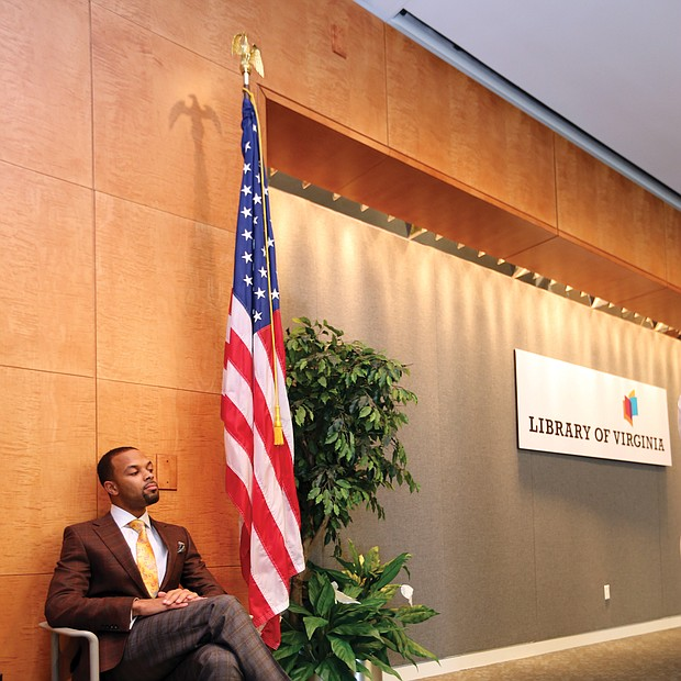"Confidently waiting: Columnist Zachary R. Woods, author of ""Uncensored: My Life and Uncomfortable Conversations at the Intersection of Black  and White America,"" listens as he is introduced as the first speaker of the 2019 Carole Weinstein Author Series at the Library of Virginia in Downtown on March 5. The next speaker in the free series is Khizr Khan, author of ""An American Family: A Memoir of Hope and Sacrifice."" He will speak at 5:30 p.m. Thursday, April 4. Details: www.lva.virginia.gov. (Regina H. Boone/Richmond Free Press)"