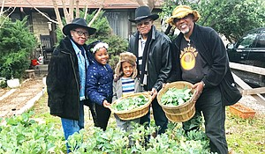 Professor Freedom with Al and Lela Herron and their grandchildren, Brooklyn and Braxton Bruff after picking collard greens.
