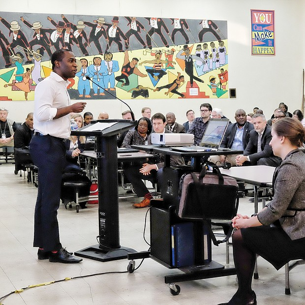 Stumping for his budget: Mayor Levar M. Stoney calls for support of his plan to raise taxes to generate more money for schools and street paving. He was speaking Tuesday night at Woodville Elementary School, the first of four town hall meetings designed to garner community support on the budget plan. Mayor Stoney got little pushback from an audience of 70 people that was composed largely of city and public schools employees, including Richmond Public Schools Superintendent Jason Kamras, second from right. Several residents, however, expressed concern that the tax increase would be a way to ensure adequate funding for replacement of the Richmond Coliseum. Mayor Stoney responded that the Coliseum project is not mentioned in the budget, nor is the Coliseum proposal ready to present to City Council. (Sandra Sellars/Richmond Free Press)