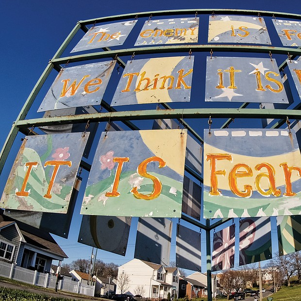 "Large, triangular public art stands on the future site of the Historic Fulton Memorial Park at 5001 Williamsburg Road at the foot of Powhatan Hill in the East End. The main element of the unsigned work is a quote from Mahatma Gandhi: ""The enemy is fear. We think it is hate; it is fear."" (Sandra Sellars/Richmond Free Press)"