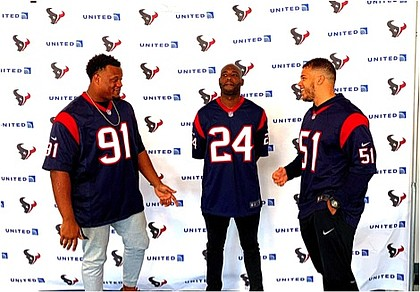 Texans players Carlos Watkins, Jonathan Joseph, and Dylan Cole mix and mingles with United Airlines customers and employees