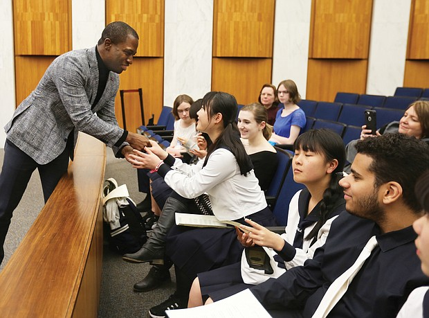 Japan 'Sister City' recognition: Richmond Mayor Levar M. Stoney greets several students from Saitama, Japan, last week during their visit to City Council chambers to recognize the 20th anniversary of Saitama's partnership with Richmond in the Sister City program. The high school students and two teachers from Urawa Municipal High School spent a week in the Richmond area through the scholastic exchange program. The students visited the Virginia Museum of Fine Arts and Maymont, where there was a welcome ceremony in the Japanese Gardens. Saitama and four other cities in Mali, Namibia, China and England have Sister City relationships with Richmond. (Regina H. Boone/Richmond Free Press)