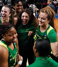 Advancing to the Final Four for the first time in program history, the Oregon Ducks Women Basketball team celebrates their 88-84 victory over Mississippi State at the Moda Center Sunday. Next up is a Friday matchup with No. 1 seed Baylor in Tampa, Fla.