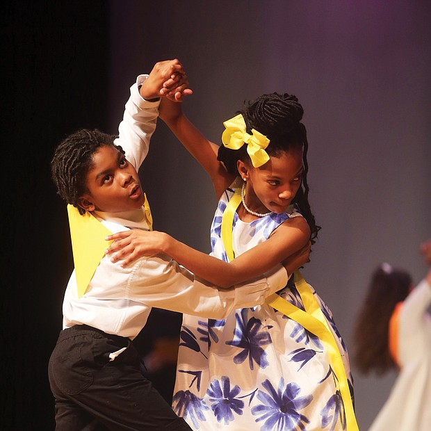 Tango togetherness: D'andre Morris, left, and Aaliya Thornhill showcase their tango moves to impress judges at a ballroom dance competition March 28 at Huguenot High School. The two fifth-graders from Overby-Sheppard Elementary were among the young people who participated in the event that Dancing Classrooms of Greater Richmond hosted. The nonprofit organization, which promotes ballroom dancing in city schools as a way to instill discipline, courtesy, teamwork and other values, provided the schoolchildren with 10 weeks of instruction before the event. (Regina H. Boone/Richmond Free Press)