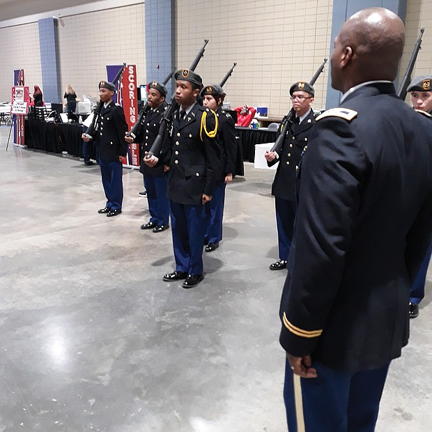 Drill ready: Army Col. Alexander Taylor observes as Cadet 2nd Lt. Taire Hubbard leads Huguenot High School's Junior ROTC team in a practice Saturday before the Richmond team faced judges in the U.S. Army Junior ROTC Drill Championship. Location: Greater Richmond Convention Center in Downtown. The team that Col. Taylor instructs was one of 103 high school units that came from as far away as Hawaii and Oregon to take part in the daylong event in Richmond. More than 2,500 teens showcased their military abilities at the event. Richmond beat out six other cities to host the championship for the first time. Army officials said they hope to return next year. (Jeremy M. Lazarus/Richmond Free Press)