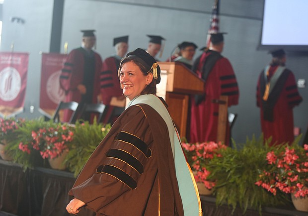 """Reynolds inaugurates new president: Dr. Paula P. Pando is all smiles after her inauguration last Friday as J. Sargeant Reynolds Community College's fourth president. The ceremony, held at the Dewey Gottwald Center at the Science Museum of Virginia, carried the theme """"Equity Through Action."""" Dr. Pando, who immigrated with her family to the United States from Chile when she was young, was the first in her family to earn a college degree. She has worked in higher education for more than 20 years, beginning as director of campus activities and programs at Saint Peter's University in Jersey City, N.J. She later joined Hudson County Community College in Jersey City and rose through the ranks, holding three different vice president positions. She was senior vice president for student and educational services there when she was chosen from among 102 applicants in a national search to lead J. Sargeant Reynolds Community College. The college serves more than 15,000 students annually on campuses in Richmond, Henrico and Goochland.  (Regina H. Boone/Richmond Free Press)"""