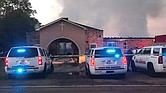 Law enforcement remains at the scene of the fire that destroyed Greater Union Baptist Church in Opelousas, La.