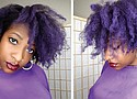 Electra Davis, founder of Mysteek Naturals, wearing her hair in Royal Purple