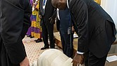 Pope Francis kneels to kiss the feet of South Sudan's First Vice President Taban Deng Gai on April 11 at the close of a two-day spiritual retreat at the Vatican designed to bring unity to the African nation's opposing factions.